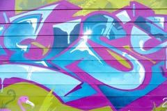 Kleurrijke graffiti op een bakstenen muur Royalty-vrije Stock Afbeeldingen