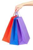 Kleurrijke het winkelen ter beschikking geïsoleerdeo zakken royalty-vrije stock fotografie