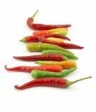 Kleurrijke hete peper in een rij Stock Foto's