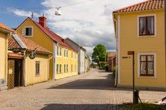 Kleurrijke houtgebouwen. Vadstena. Zweden Stock Foto