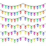 Kleurrijke Kerstmislichten op witte achtergrond Royalty-vrije Stock Afbeeldingen
