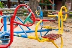 Kleurrijke kinderencarrousel in speelplaats Speelgoed voor illustratie children Stock Fotografie