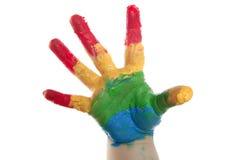 Kleurrijke kinderenhand die over wit wordt geschilderd stock afbeeldingen