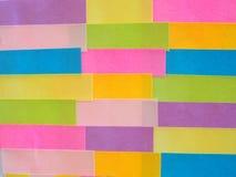 Kleurrijke kleverige nota's als achtergrond Stock Fotografie