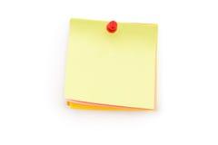 Kleurrijke kleverige nota's met duwspeld op wit Stock Afbeelding