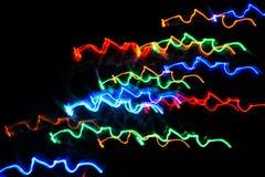 Kleurrijke lichten die zich in dark bewegen Abstractie royalty-vrije stock foto
