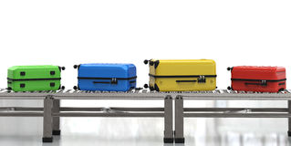 Kleurrijke luggages op transportband Stock Foto's