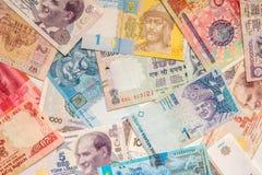 Kleurrijke oude het bankbiljetachtergrond van het Wereldpapiergeld Stock Afbeelding