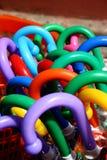 Kleurrijke parapluhandvatten Stock Afbeeldingen