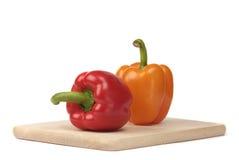Kleurrijke peper op de raad Royalty-vrije Stock Foto