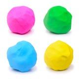 Kleurrijke roze groenachtig blauwe en gele plasticineklei Stock Foto's