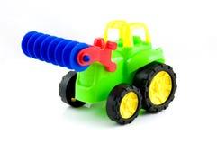 Kleurrijke stuk speelgoed tractor Stock Foto