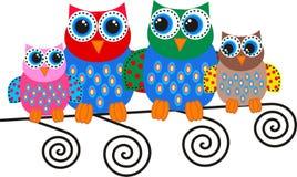Kleurrijke uilfamilie Stock Foto's