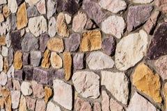 Kleurrijke van de het natuursteenbakstenen muur van het land de textuurachtergrond Stock Afbeeldingen