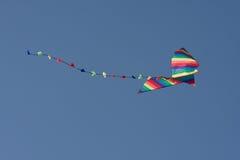 Kleurrijke vlieger in de lucht Stock Foto's