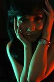 Kleurrijke vrouw in zwarte Stock Foto's