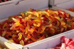 Kleverig suikergoed Jelly Candies Kleverige beren of wormen Mengeling van kleverig suikergoed De achtergrond van het geleisuikerg stock afbeeldingen