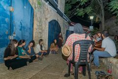Klezmer Festival 2018 in Safed Tzfat. Safed, Israel - August 14, 2018: The Klezmer Festival, with people listen to street musicians, in Safed Tzfat, Israel. Its royalty free stock photos