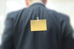 Klibbig anmärkning på affärsman Arkivbild