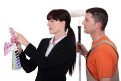 Klient, der dem Maler nimmt Stockbild