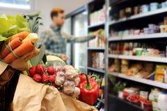 Klient przy sklepem spożywczym Obraz Royalty Free