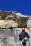 Klimmers op de route Stock Foto's