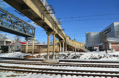 Klin, Russia - February 27. 2016. Pedestrian bridge over the railroad tracks at  station Royalty Free Stock Photos