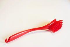 Klingerytu muśnięcie dla myć naczynia na białym tle Fotografia Royalty Free