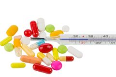 Klinischer Thermometer und Pillen Lizenzfreie Stockfotos