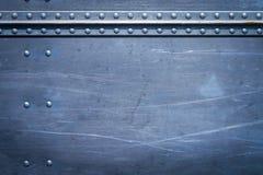 Klinknagels op metaal Stock Afbeelding