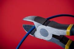 Klipp den blåa tråden Arkivbild