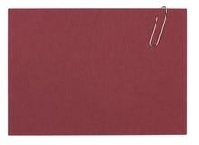 Klipp, der ein Blatt des unbelegten Papiers anhält Stockfoto