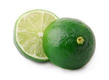 Klipp grön limefrukt som isoleras på vit bakgrund Fotografering för Bildbyråer