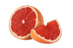 Klipp grapefruktfrukter på vit bakgrund Arkivfoto