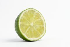 klipp half limefrukt Arkivfoto
