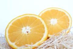 Klipp halv apelsin två Fotografering för Bildbyråer