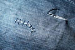 klipp jeanstextur Arkivfoto