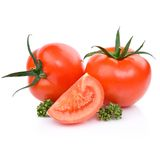 klipp ny röd tomat två Arkivfoton