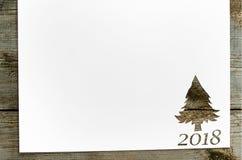 Klipp papper i gran-träd form på tabellen Fotografering för Bildbyråer