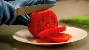 Klipp tomatskivor arkivfilmer