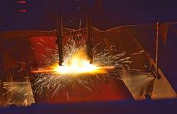 Klippa av den varma metallen Arkivbild