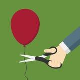 Klippa en röd ballong med Scissor Fotografering för Bildbyråer