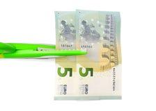 Klippa kostnadsbegrepp med pengar, sax Arkivbilder