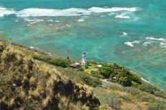 Klippor av Diamond Head And Lighthouse arkivfoto