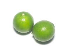 klippte svarta cirklar för bakgrund grön limefrukt Royaltyfri Fotografi