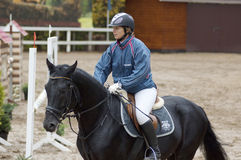 A.Klishina ride on horse Stock Images