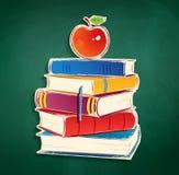 Klistermärke med högen av böcker och äpplet Arkivbilder