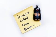 Klistermärke - någon som kallas från banken och den roliga vågbrytaren Royaltyfri Foto