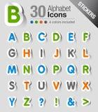 Klistermärkear - alfabet Arkivfoton