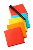 Klistermärkear och blyertspennor som isoleras på en vit Royaltyfria Foton